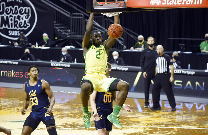 Oregon  forward Eugene Omoruyi (2) dunks as California forward D.J. Thorpe (33) watches during the second half of an NCAA college basketball game Thursday, Dec. 31, 2020, in Eugene, Ore. (AP Photo/Andy Nelson)
