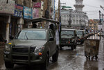 Pakistani soldiers patrol outside a mosque in Rawalpindi, Pakistan, Friday, March 27, 2020. Authorities imposed nation-wide lockdown appealed people to avoid public gatherings like Friday congregations and offer their prayers at home as a preventive measures to contain the spread of coronavirus. The virus causes mild or moderate symptoms for most people, but for some, especially older adults and people with existing health problems, it can cause more severe illness or death. (AP Photo/B.K. Bangash)