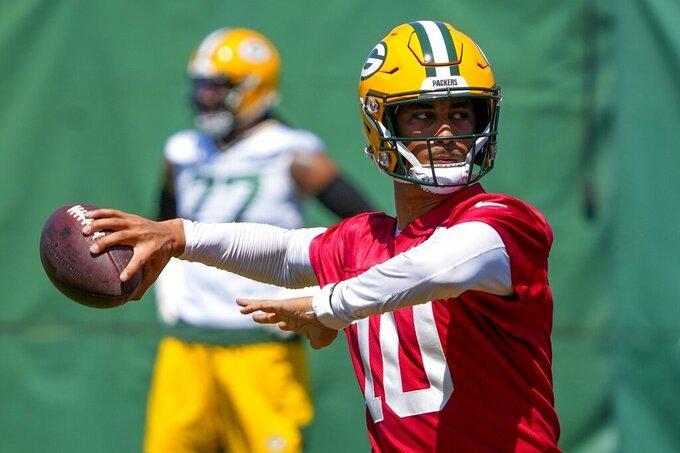 Green Bay Packers' Jordan Love runs a drill during an NFL football minicamp Tuesday, June 8, 2021, in Green Bay, Wis. (AP Photo/Morry Gash)