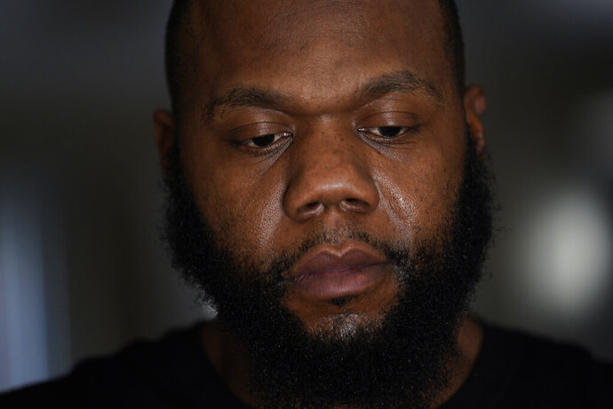 Leon Abdullah El-Alamin is shown at his home in Mt. Morris Township, Mich., Wednesday, Jan. 13, 2021. (AP Photo/Paul Sancya)