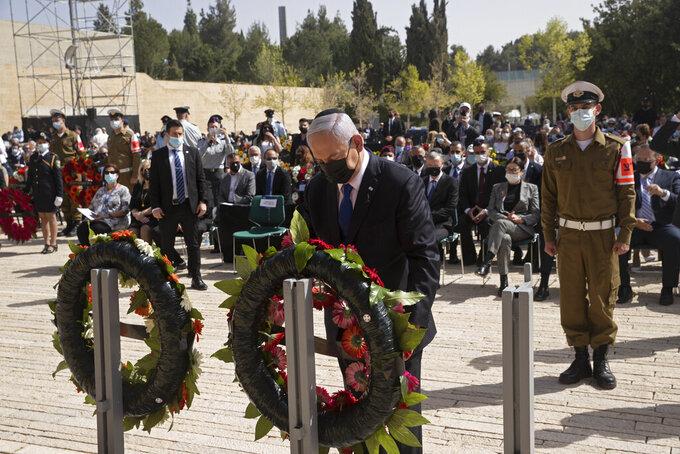 Israeli Prime Minister Benjamin Netanyahu lays a wreath at a ceremony marking the annual Holocaust Remembrance Day, at Yad Vashem Holocaust Memorial in Jerusalem, Thursday, April 8, 2021. (AP Photo/Maya Alleruzzo, Pool)