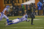 Wake Forest quarterback Jamie Newman, right, breaks free from Duke safety Dylan Singleton (16) for a 42-yard touchdown run in the first half of an NCAA college football game in Winston-Salem, N.C., Saturday, Nov. 23, 2019. (AP Photo/Nell Redmond)