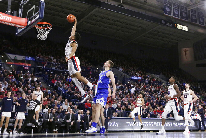 Gonzaga guard Admon Gilder (1) goes up for a dunk in front of BYU guard Jake Toolson (5) during the second half of an NCAA college basketball game in Spokane, Wash., Saturday, Jan. 18, 2020. Gonzaga won 92-69. (AP Photo/Young Kwak)