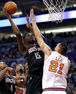 Houston Rockets center Clint Capela (15) shoots over Phoenix Suns center Alex Len (21) during the first half of an NBA basketball game Friday, Jan. 12, 2018, in Phoenix. (AP Photo/Matt York)