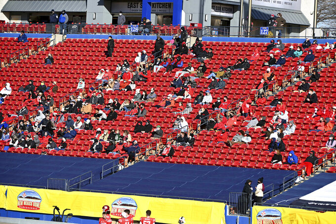 Fans watch the first quarter of the New Mexico Bowl NCAA college football game between Houston and Hawaii in Frisco, Texas, Thursday, Dec. 24, 2020. (AP Photo/Matt Strasen)