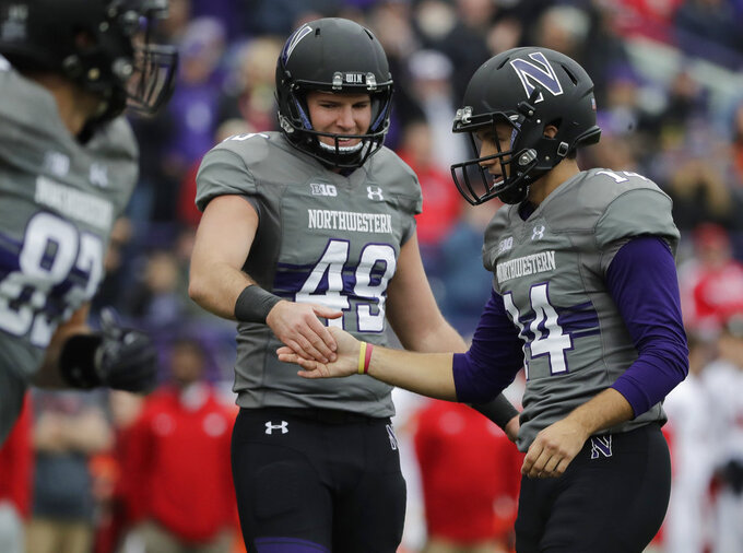 Northwestern kicker Charlie Kuhbander, right, celebrates with punter Jake Collins after scoring a field goal against Wisconsin during the second half of an NCAA college football game in Evanston, Ill., Saturday, Oct. 27, 2018. (AP Photo/Nam Y. Huh)