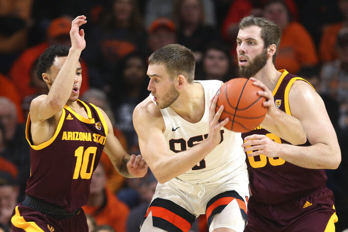 Arizona State's Jaelen House, left, and Mickey Mitchell, right, pressure Oregon State's Tres Tinkle during the second half of an NCAA college basketball game in Corvallis, Ore., Thursday, Jan. 9, 2020. (AP Photo/Chris Pietsch)