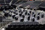 Voting machines fill the floor for early voting at the State Farm Arena on Monday, Oct. 12, 2020, in Atlanta. (AP Photo/Brynn Anderson)