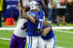 Indianapolis Colts quarterback Philip Rivers (17) is hit by Baltimore Ravens defensive end Yannick Ngakoue (91) as he throws in the first half of an NFL football game in Indianapolis, Sunday, Nov. 8, 2020. (AP Photo/AJ Mast)