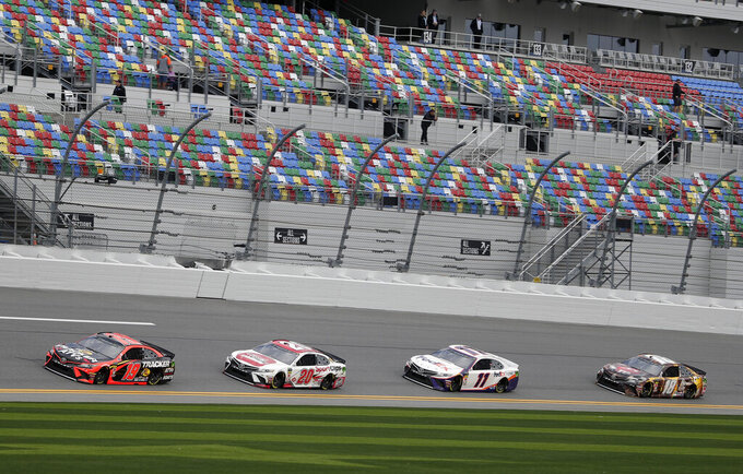 NASCAR drivers, from left, Martin Truex Jr. (19), Erik Jones (20), Denny Hamlin (11) and Kyle Busch (18) runs practice laps during auto race practice at Daytona International Speedway, Saturday, Feb. 9, 2019, in Daytona Beach, Fla. (AP Photo/John Raoux)