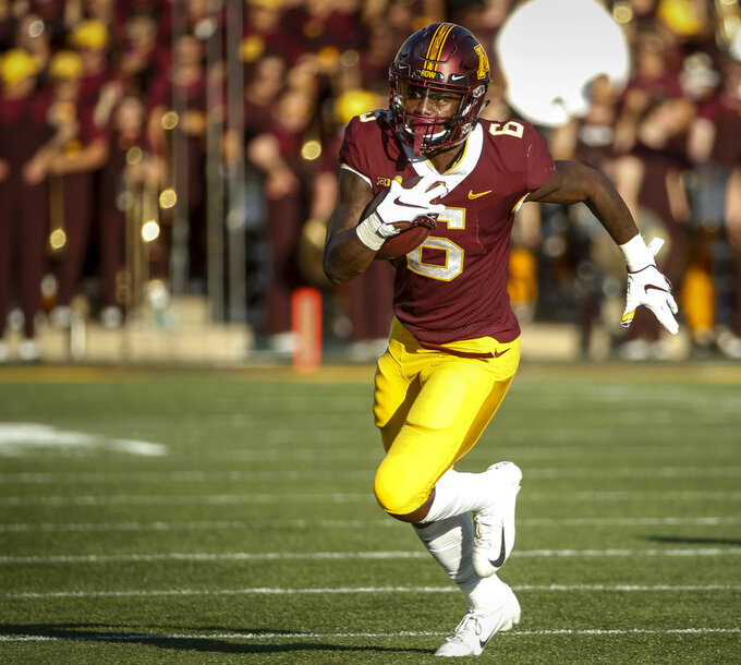 FILE - In this Sept. 15, 2018, file photo, Minnesota wide receiver Tyler Johnson catches a pass against Miami (Ohio) in the second half of an NCAA football game, in Minneapolis. For the season, he leads the Big Ten with 100.9 yards receiving per game and is tied for the lead with eight TD catches.  (AP Photo/Bruce Kluckhohn, File)