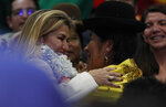 Bolivia's interim President Jeanine Anez embrace with a woman after a ceremony announce her nomination as presidential candidate for the May 3 elections in La Paz, Bolivia, Friday, Jan. 24, 2020. (AP Photo/Juan Karita)