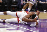Miami Heat guard Dwyane Wade lies on the court after he hit his head following a hard landing during the first quarter of the team's NBA basketball game against the Sacramento Kings. Friday, Feb. 8, 2019, in Sacramento, Calif. Wade left the game. (AP Photo/Rich Pedroncelli)