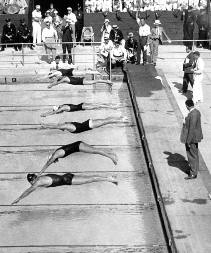 FILE - In this Aug. 10, 1932, file photo, Olympic competitors dive into the pool at the start of the 400-meter freestyle men's swimming race at the Summer Olympic Games in Los Angeles. Buster Crabbe, of the United States, shown nearest the camera, won the gold medal, setting an Olympic record with a time of 4:48.4. (AP Photo/File)