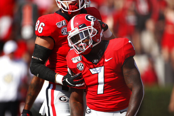 Georgia running back D'Andre Swift (7) celebrates with Georgia tight end John FitzPatrick (86) after scoring a touchdown against Murray State during the first half of an NCAA college football game Saturday, Sept. 7, 2019, in Athens, Ga. (Joshua L. Jones/Athens Banner-Herald via AP)