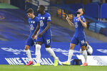 Chelsea's Olivier Giroud, right, celebrates after scoring his side's opening goal during the English Premier League soccer match between Chelsea and Watford at the Stamford Bridge stadium in London, Saturday, July 4, 2020. (Glynn Kirk/Pool via AP)