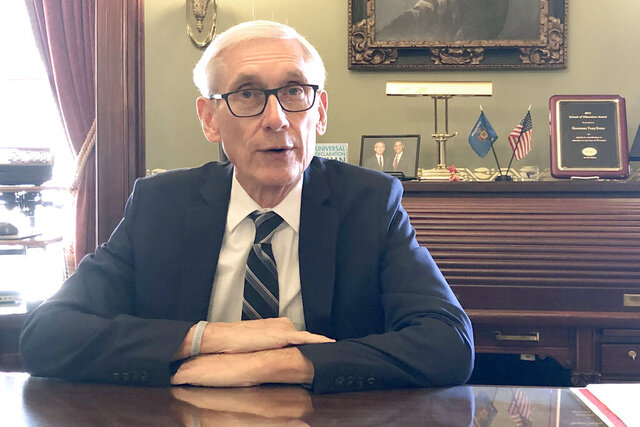 Wisconsin Gov. Tony Evers sits for an interview with The Associated Press Thursday, Dec. 19, 2019, saying that Foxconn Technology Group, the world's largest electronics manufacturer, could still qualify for up to $3 billion in state tax credits in Wisconsin if it makes changes to its deal with the state to reflect current plans for a plant that's under construction. Evers said Thursday.