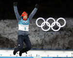 Gold medalist Laura Dahlmeier, of Germany, leaps in the air during the venue ceremony at the women's 10-kilometer biathlon pursuit at the 2018 Winter Olympics in Pyeongchang, South Korea, Monday, Feb. 12, 2018. (AP Photo/Andrew Medichini)
