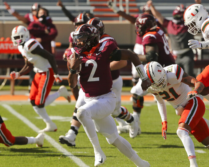 Virginia Tech's Hendon Hooker, center, runs for a touchdown during the first half of an NCAA college football game Saturday, Nov. 14, 2020, in Blacksburg, Va. (Matt Gentry/The Roanoke Times via AP, Pool)