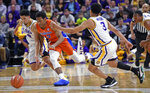 LSU guard Skylar Mays (4), Florida guard KeVaughn Allen (5) and LSU guard Tremont Waters (3) chase the ball in overtime of an NCAA college basketball game Wednesday, Feb. 20, 2019, in Baton Rouge, La. Florida won 82-77. (AP Photo/Bill Feig)