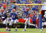 Florida quarterback Kyle Trask (11) throws a pass against South Carolina during an NCAA college football game in Gainesville, Fla., Saturday, Oct. 3, 2020. (Brad McClenny/The Gainesville Sun via AP, Pool)