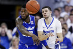 Creighton's Marcus Zegarowski, right, passes the ball while defended by Seton Hall's Myles Cale (22) during the first half of an NCAA college basketball game in Omaha, Neb., Saturday, March 7, 2020. (AP Photo/Nati Harnik)