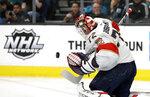 Florida Panthers goalie Sergei Bobrovsky blocks a shot from the San Jose Sharks in the first period of an NHL hockey game Monday, Feb. 17, 2020, in San Jose, Calif. (AP Photo/Ben Margot)