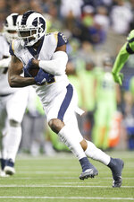 Los Angeles Rams tight end Gerald Everett (81) gains yardage after catching the ball in an NFL game against the Seattle Seahawks, Thursday, Oct. 3, 2019, in Seattle. The Seahawks defeated the Rams 30-29. (Margaret Bowles via AP)