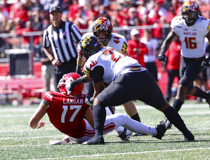 Rutgers quarterback Johnny Langan (17) is slammed to the turf by Maryland defensive lineman Bryce Brand (27) for a sack in the first half of an NCAA college football game, Saturday Oct. 5, 2019, in Piscataway, N.J. (Andrew Mills/NJ Advance Media via AP)