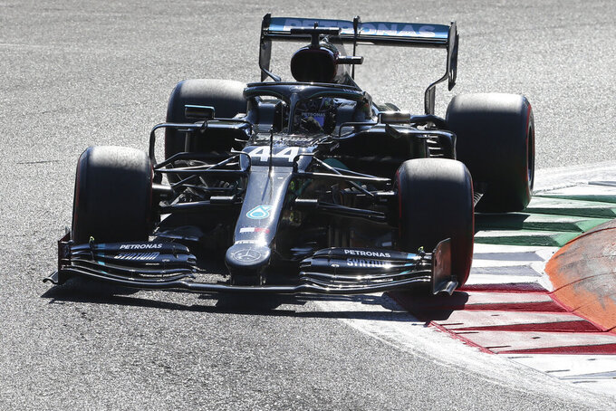 Mercedes driver Lewis Hamilton of Britain steers his car during the qualifying session at the Monza racetrack in Monza, Italy, Saturday, Sept.5, 2020. The Italian Formula One Grand Prix will be held on Sunday. (Matteo Bazzi, Pool via AP)