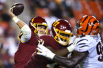 Washington Football Team quarterback Taylor Heinicke (4) throws under pressure during the first half of the team's preseason NFL football game against the Cincinnati Bengals, Friday, Aug. 20, 2021, in Landover, Md. (AP Photo/Nick Wass)
