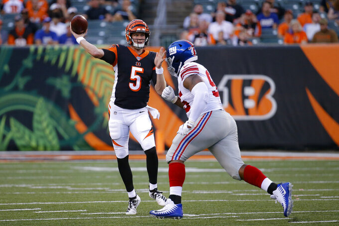 Cincinnati Bengals quarterback Ryan Finley (5) passes under pressure from New York Giants defensive lineman B.J. Hill (95) during the first half of an NFL preseason football game Thursday, Aug. 22, 2019, in Cincinnati. (AP Photo/Frank Victores)