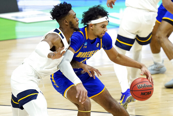 Morehead State's Johni Broome, right, is defended by West Virginia's Derek Culver, left, during the first half of a college basketball game in the first round of the NCAA tournament at Lucas Oil Stadium Friday, March 19, 2021, in Indianapolis. (AP Photo/Mark Humphrey)