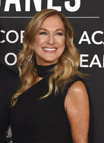 FILE - This Nov. 13, 2019 file photo shows Recording Academy President Deborah Dugan at the Latin Recording Academy Person of the Year gala honoring Juanes in Las Vegas. Dugan has fired back at the Recording Academy with a complaint claiming she was retaliated against after reporting she was subjected to sexual harassment and gender discrimination during her six-month tenure. Lawyers for Dugan, who the academy placed on administrative leave last week, filed a discrimination case with the Equal Employment Opportunity Commission on Tuesday. In the complaint, she claims she was subjected to sexual harassment from the academy's general counsel. (Photo by Chris Pizzello/Invision/AP, File)