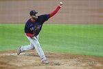 Boston Red Sox starting pitcher Eduardo Rodriguez throws in the first inning of a baseball game against the Texas Rangers in Arlington, Texas, Saturday, May 1, 2021. (AP Photo/Louis DeLuca)