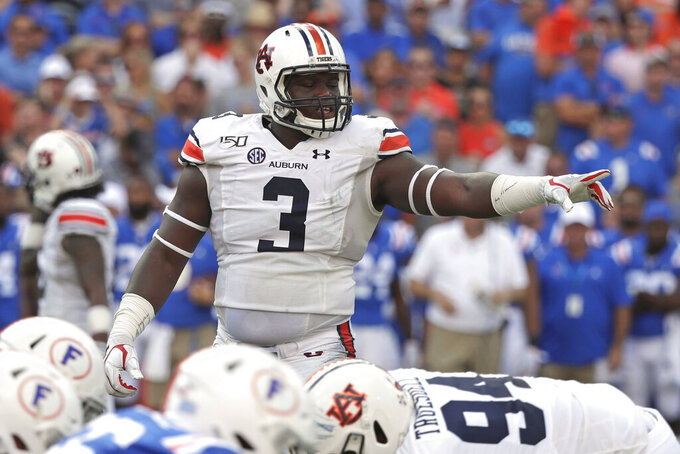 FILE - In this Oct. 5, 2019, file photo, Auburn defensive end Marlon Davidson (3) signals to teammates before a play during the first half of an NCAA college football game against Florida, in Gainesville, Fla. Davidson was selected to The Associated Press All-Southeastern Conference football team, Monday, Dec. 9, 2019.(AP Photo/John Raoux, File)