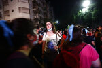 An anti-abortion activist reacts as others leave after lawmakers passed a bill that legalizes abortion, outside Congress in Buenos Aires, Argentina, Wednesday, Dec. 30, 2020. (AP Photo/Marcos Brindicci)