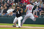 Los Angeles Angels' Phil Gosselin beats the throw to Jose Abreu for an RBI infield single during the third inning of a baseball game Wednesday, Sept. 15, 2021, in Chicago. Gosselin was originally called out, but the call was overturned after video review. (AP Photo/Charles Rex Arbogast)
