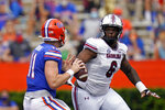 South Carolina defensive lineman Zacch Pickens (6) puts pressure on Florida quarterback Kyle Trask, left, as he looks for a receiver during the first half of an NCAA college football game, Saturday, Oct. 3, 2020, in Gainesville, Fla. (AP Photo/John Raoux, Pool)