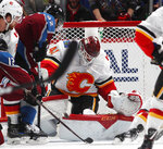 Calgary Flames goaltender Mike Smith, right, makes a stop of a shot by Colorado Avalanche left wing Gabriel Landeskog in the second period of Game 3 of a first-round NHL hockey playoff series, Monday, April 15, 2019, in Denver. (AP Photo/David Zalubowski)