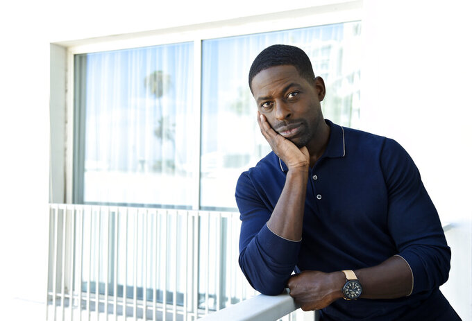 """FILE - Actor Sterling K. Brown, a cast member in the NBC series """"This Is Us,"""" poses for a portrait during the 2017 Television Critics Association Summer Press Tour in Beverly Hills, Calif. on Aug. 3, 2017. Season five debuts Tuesday and will address the pandemic and Black Lives Matter movement. (Photo by Chris Pizzello/Invision/AP, File)"""