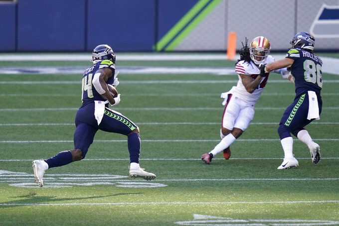 Seattle Seahawks wide receiver DK Metcalf (14) runs for a touchdown after a reception against the San Francisco 49ers during the first half of an NFL football game, Sunday, Nov. 1, 2020, in Seattle. (AP Photo/Elaine Thompson)