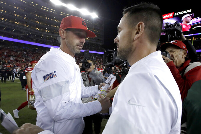 San Francisco 49ers head coach Kyle Shanahan, left, greets Green Bay Packers head coach Matt LaFleur after an NFL football game in Santa Clara, Calif., Sunday, Nov. 24, 2019. (AP Photo/Ben Margot)