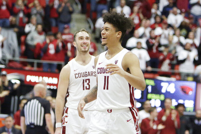 Washington State forward DJ Rodman (11) and forward Jeff Pollard (13) react towards the end of the second half of an NCAA college basketball game against Oregon State in Pullman, Wash., Saturday, Jan. 18, 2020. Washington State won 89-76. (AP Photo/Young Kwak)