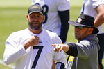 FILE- In this June 16, 2021, file photo, Pittsburgh Steelers offensive coordinator Matt Canada, right, talking with quarterback Ben Roethlisberger (7) during the team's NFL mini-camp football practice in Pittsburgh. Canada appreciates his players taking responsibility for the offense's slow start. Canada, however, believes the players will perform better if he calls better plays starting on Sunday against Cincinnati. (AP Photo/Gene J. Puskar, File)