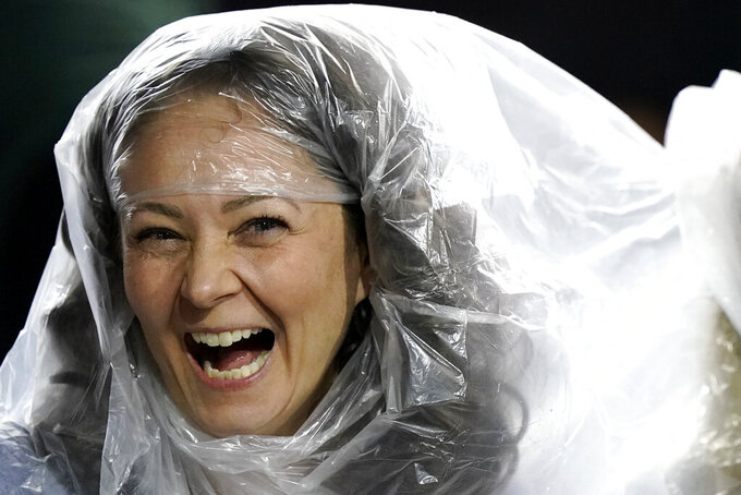 A Michigan State fan smiles as she watches during the second half of the team's NCAA college football game against Northwestern in Evanston, Ill., Friday, Sept. 3, 2021. Michigan State won 38-21. (AP Photo/Nam Y. Huh)