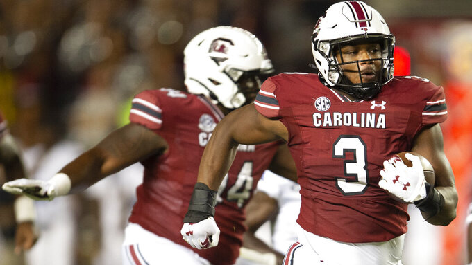 South Carolina defensive end Jordan Burch (3) returns a pick six during the second half of an NCAA college football game against against the Eastern Illinois, Saturday, Sept. 4, 2021, in Columbia, S.C. (AP Photo/Hakim Wright Sr)
