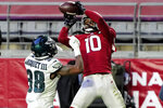 Arizona Cardinals wide receiver DeAndre Hopkins (10) scores a touchdown as Philadelphia Eagles defensive back Michael Jacquet (38) defends during the second half of an NFL football game, Sunday, Dec. 20, 2020, in Glendale, Ariz. (AP Photo/Rick Scuteri)
