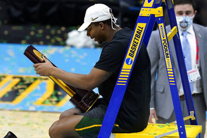 Baylor guard Mark Vital holds the trophy after the championship game against Gonzaga in the men's Final Four NCAA college basketball tournament, Monday, April 5, 2021, at Lucas Oil Stadium in Indianapolis. Baylor won 86-70. (AP Photo/Darron Cummings)