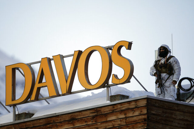 A police security guard patrols on the roof of a hotel ahead of the World Economic Forum in Davos, Switzerland, Monday, Jan. 20, 2020. The 50th annual meeting of the forum will take place in Davos from Jan. 21 until Jan. 24, 2020. (AP Photo/Markus Schreiber)